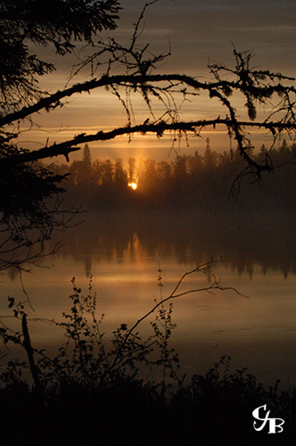 Photo: Sunrise on a trout lake in northern Minnesota. Photo by Chris J. Benson