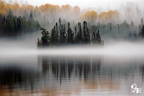 Photo: Fog surrounding an island in the BWCA in northern Minnesota. Photo by Chris J. Benson